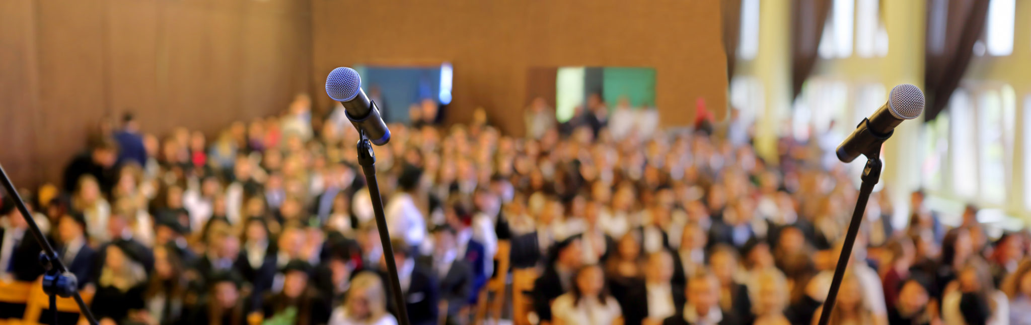 Blurred background of public event exhibition hall show concept with microphones