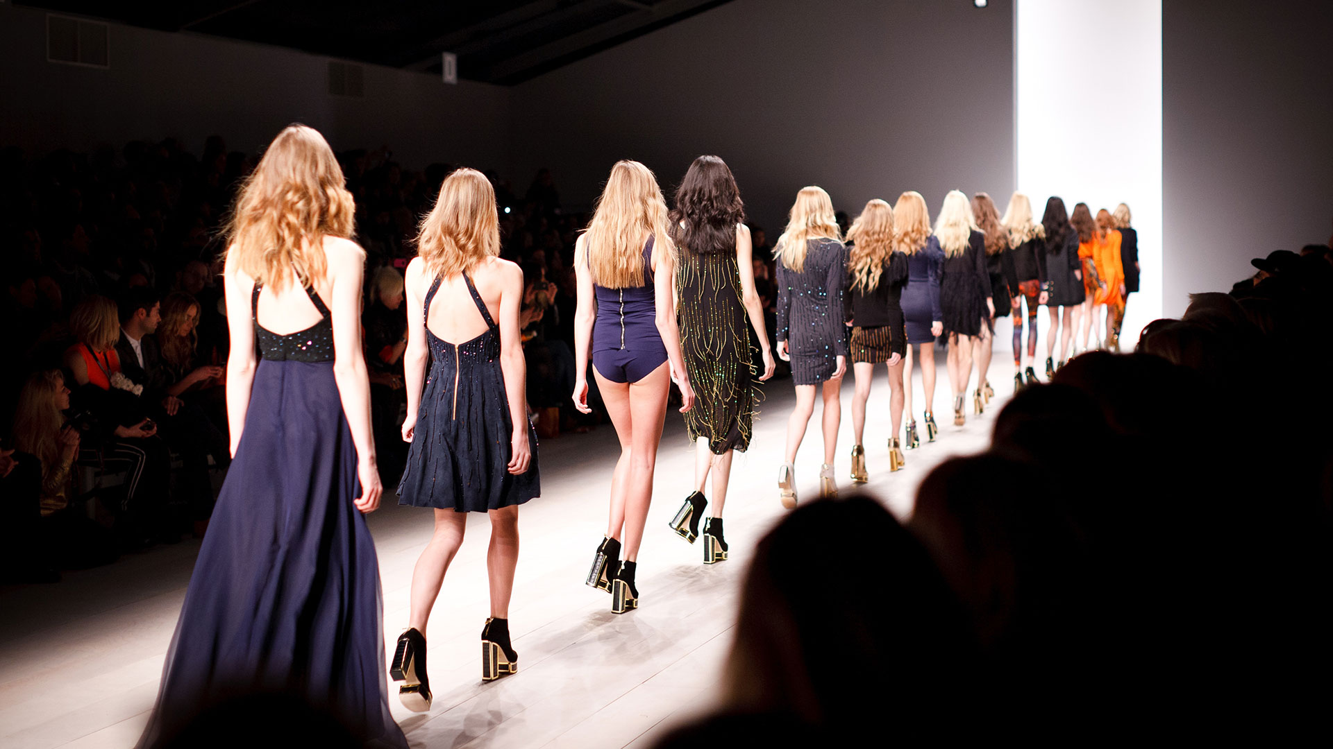 Back view of female models on catwalk
