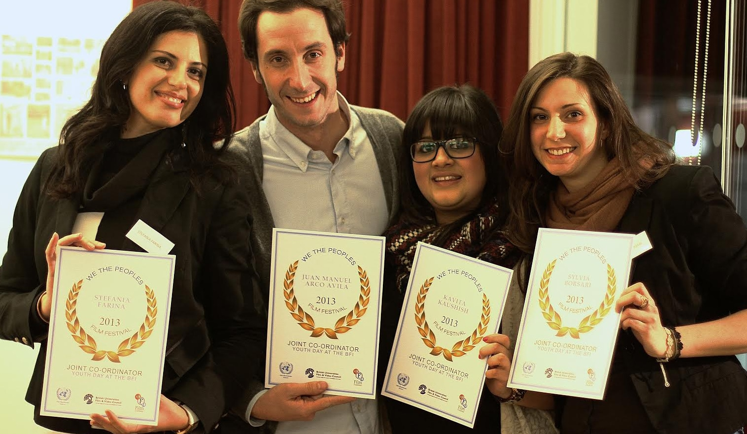 Group of Event Academy volunteers showing their We The People's award certificates
