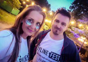 Couple wearing Byline Fest logo t shirts