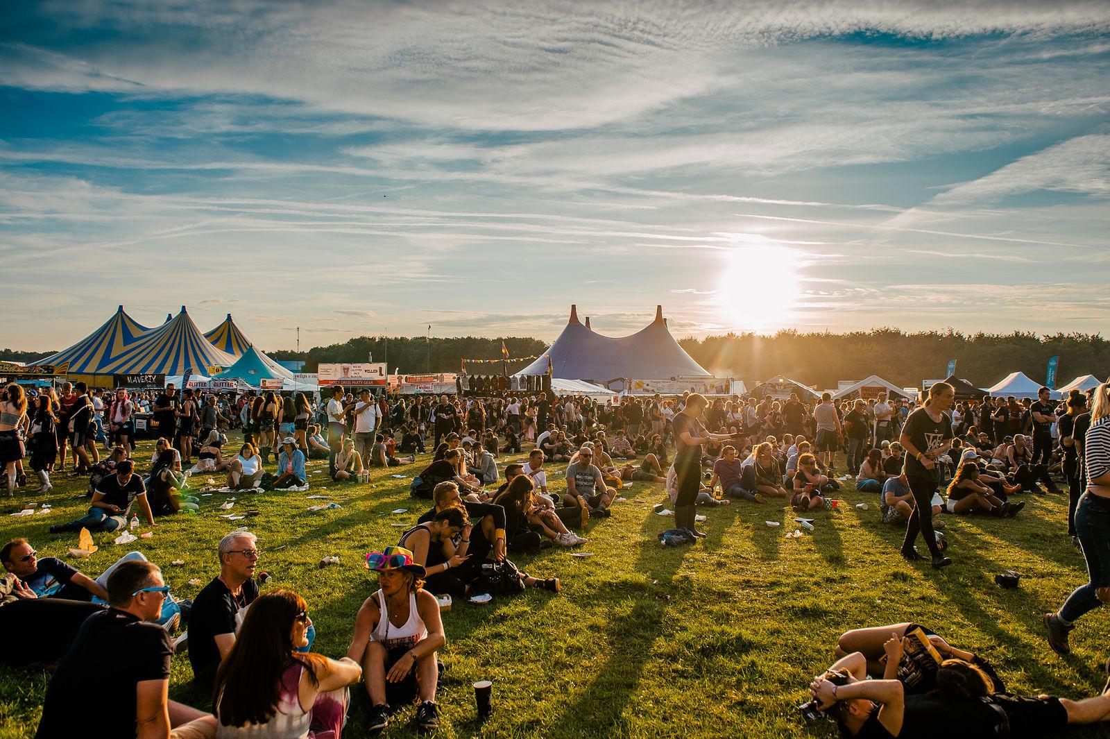 Crowds enjoying sunset at festival